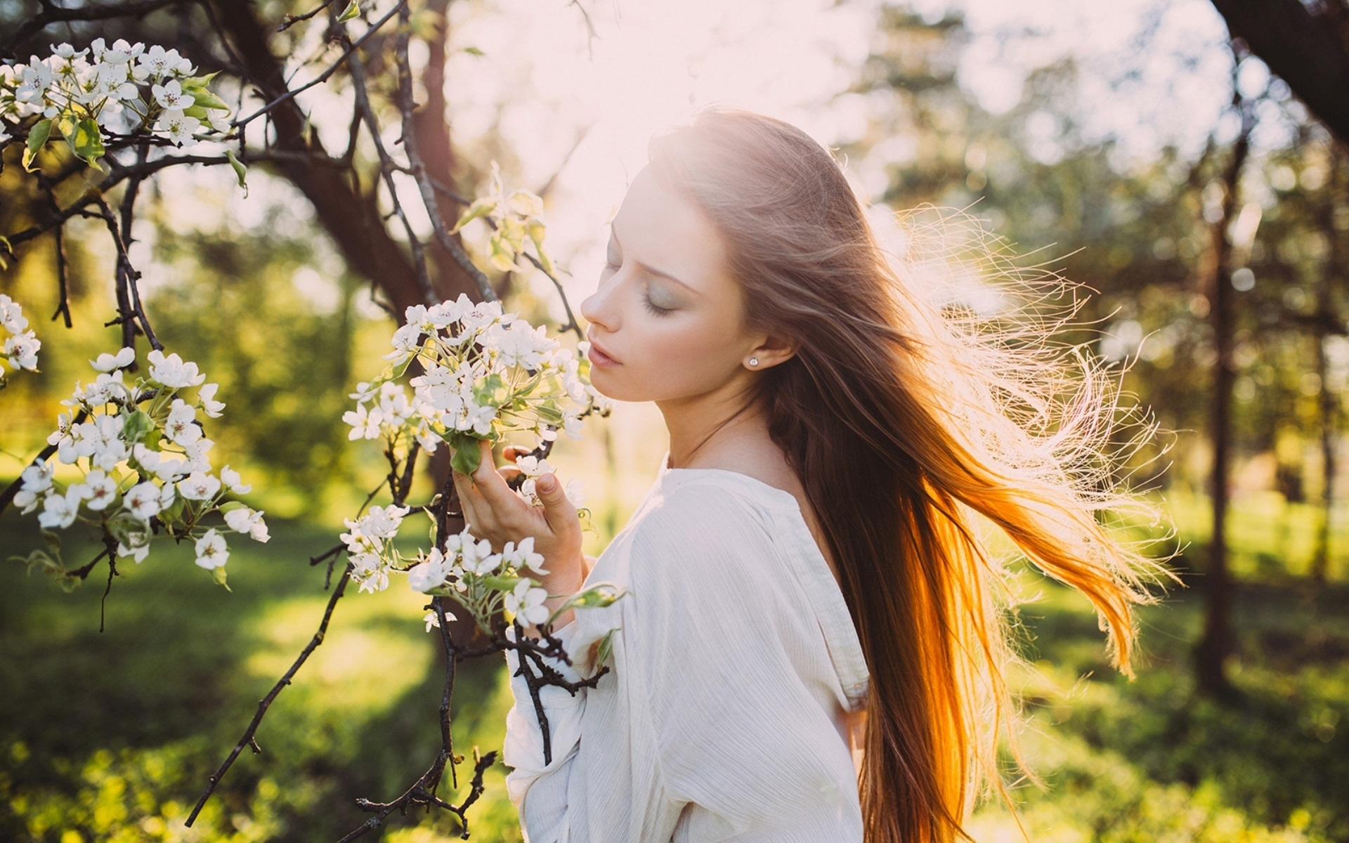 girl-hair-in-the-wind-sun-rays-spring-white-flowers-1080P-wallpaper